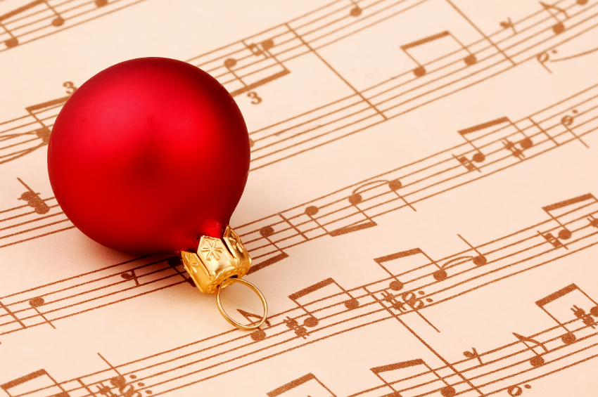 Clipart of sheet music with a Christmas bulb on top